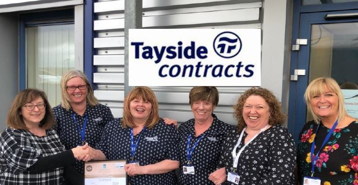 Jackie Scrimgeour presents the Gold Star Employer award to Lesley Johnstone with her colleagues Caroline Cruickshank's, Christine Innis and Tayside Contracts Facilities Business Manager Carol Haxton